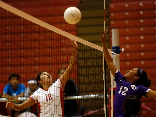 Shiprock's Tristin Morgan tips the ball toward Kirkland Central's Alexandria Cambridge Thursday at the Chieftain Pit in Shiprock.