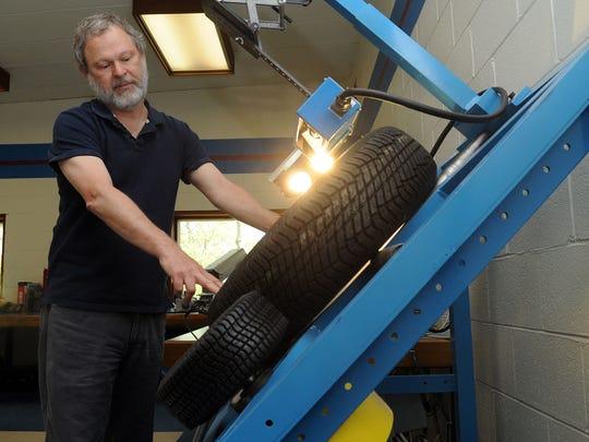 Darrell Tuttle, electronics engineer, demonstrates
