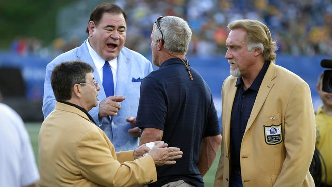 NFL Hall of fame President David Baker, talks to Brett Favre, Kevin Greene and Edward DeBartolo, Jr, after the NFL preseason game between the Green Bay Packers and Indianapolis Colts was canceled Sunday, August 7, 2016, in Canton, Ohio.