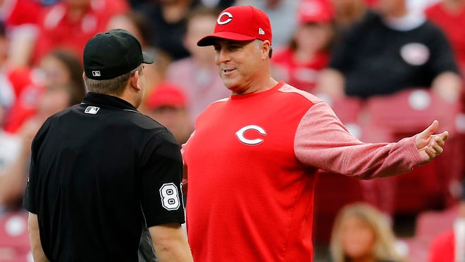 Cincinnati Reds manager Bryan Price (38) argues a call after shortstop Zack Cozart (2) is called out for interference on his way to first base in the bottom of the first inning of the MLB interleague game between the Cincinnati Reds and the Cleveland Indians at Great American Ball Park in downtown Cincinnati on Tuesday, May 23, 2017. The Reds led the Indians 3-1 after two innings.