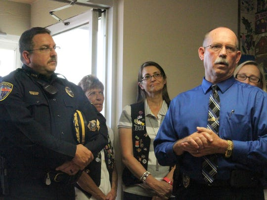 Alamogordo Police Chief Daron Syling (L) and Deputy Police Chief Roger Schoolcraft (R) spoke during the Kid's Inc. ribbon cutting ceremony and open house Friday. Schoolcraft said he is proud of what the community has accomplished in help to protect children.