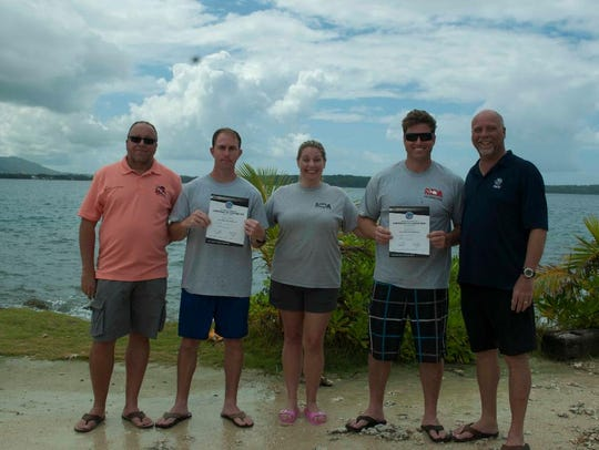 Newest PADI Instructors: Pictured from from left to