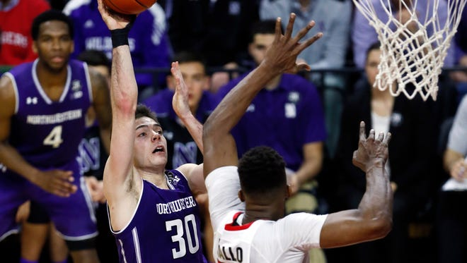 Northwestern Wildcats guard Bryant McIntosh (30) shoots over Rutgers at the RAC in January