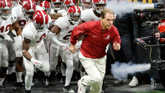 FILE - In this Jan. 8, 2018, file photo, Alabama head coach Nick Saban leads his team on the field before the NCAA college football playoff championship game against Georgia, in Atlanta. The AP preseason Top 25 is out, and for the third straight year Alabama is No. 1. (AP Photo/David Goldman, File)