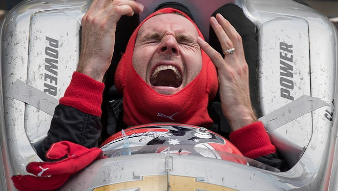 Team Penske IndyCar driver Will Power (12) celebrates winning the102nd running of the Indianapolis 500 at Indianapolis Motor Speedway on Sunday, May 27, 2018.