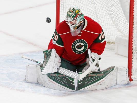 FILE - In this Tuesday, March 7, 2017, file photo, Minnesota Wild goalie Devan Dubnyk deflects a shot during the first period of an NHL hockey game against the St. Louis Blues in St. Paul, Minn. NHL teams with long winning streaks have struggled in the aftermath of them this season. While the Wild bucked the trend, the Columbus Blue Jackets steadied themselves after some struggles and the Washington Capitals are working on getting back on track. (AP Photo/Jim Mone, File)