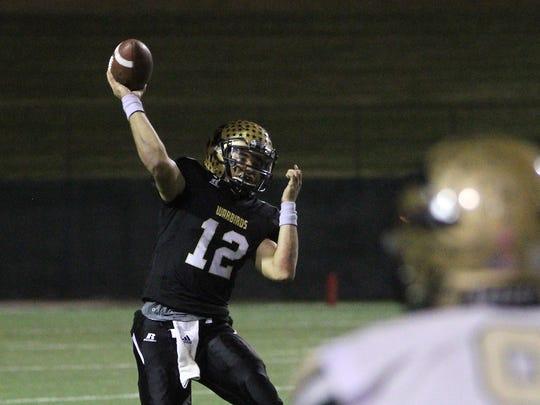 Abilene's Peyton Killam completes a pass against Desoto in the Region I-6A Division II semifinal Friday, Nov. 25, 2016, at Memorial Stadium in Wichita Falls.