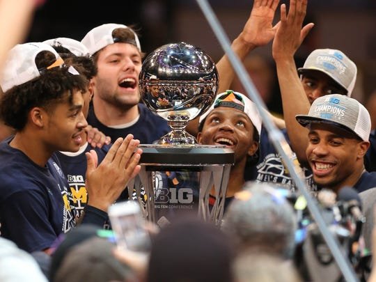 The Michigan Wolverines celebrate winning the Big Ten Tournament Championship 75-66 over Purdue on Sunday, March 4, 2018 at Madison Square Garden in New York.Free Press