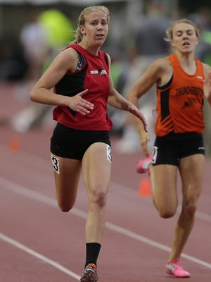 Newman Catholic's Julianne Barkholz races towards the finish line while competing in the Div. 3 200 meters during the WIAA state track last June.