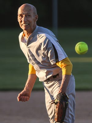 Louie Markovich delivers a fast-pitch from the mound during a league game at Oren J. Alexander softball park, Indianapolis, Wednesday, June 7, 2017. The 80-year-old pitcher plays weekly and is an avid runner.