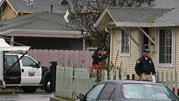 Investigators gathering information from the scene of an officer-involved shooting