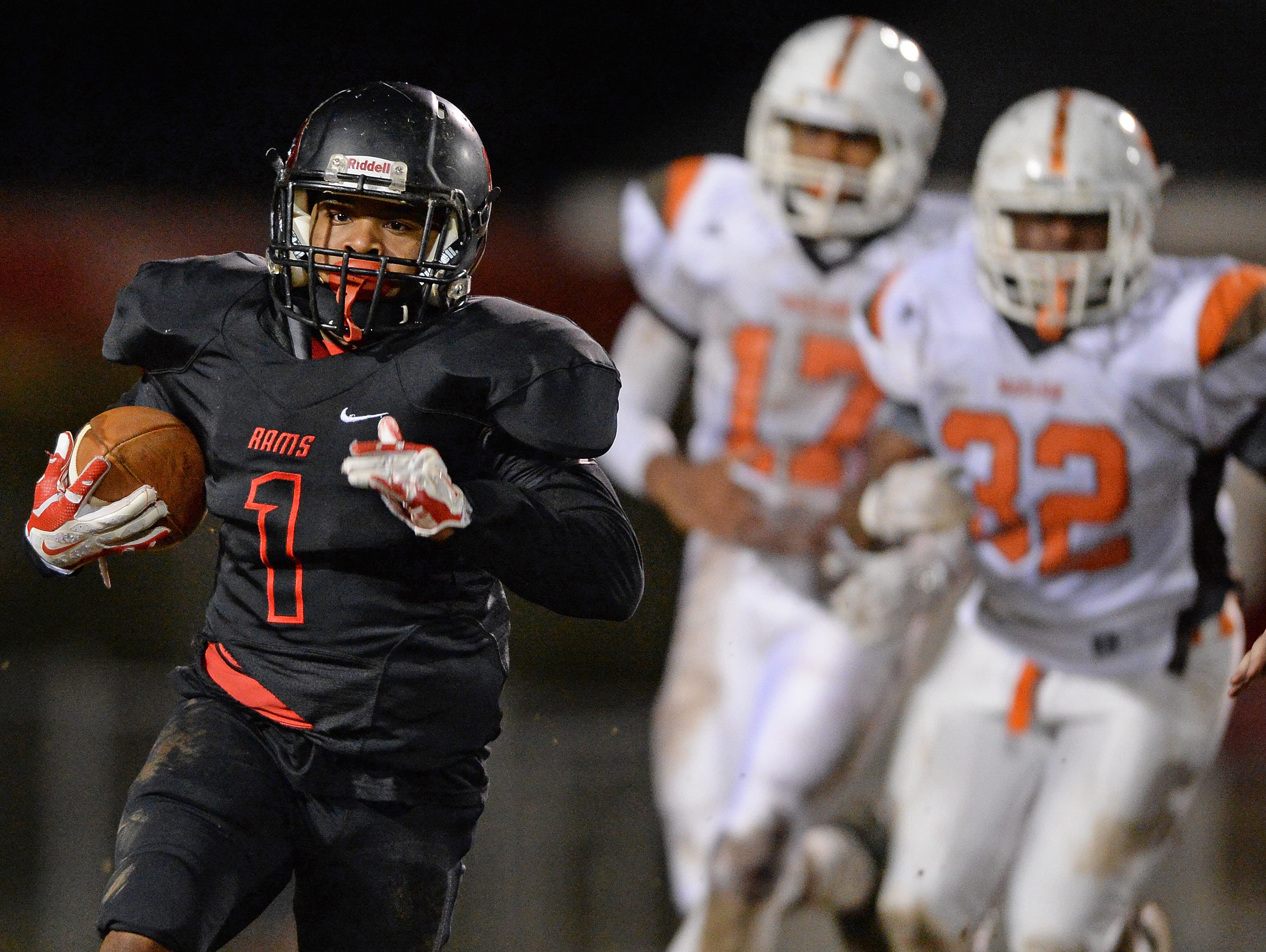 Hillcrest's Quintavis Ballenger (1) carries against Mauldin during the first round of the Class AAAA Division-I playoffs Friday, November 20, 2015 at Hillcrest High.