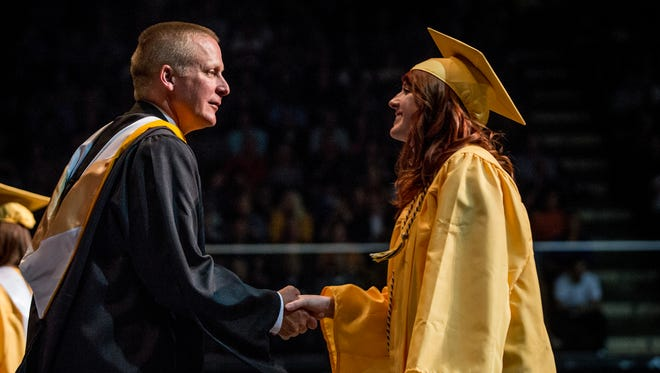 Principal Charles Mossett shakes hands with graduates during Port Huron Northern High School's commencement ceremony Wednesday, June 7, 2017 at McMorran Arena.