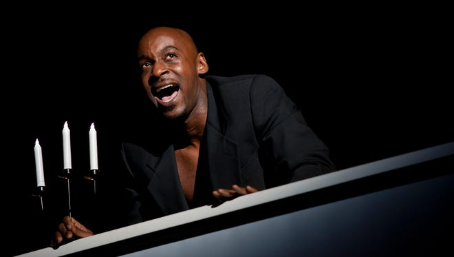 Rickey Eubanks performs as Riff Raff during a dress rehearsal for the Rocky Horror Show Tuesday, Oct. 21, 2014 at McMorran Theater.