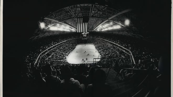 In this Oct. 1, 1988, photo that ran in the Milwaukee Journal, fans are shown watching the action between the Edmonton Oilers and Chicago Blackhawks in the first event held at the Bradley Center. Mark Kopplin and his brothers-in-law (Jim Voss, Rich Cieslak) attended the game in the back row of the building, and they'll return to the same seats -- Section 438, Row X -- in the April 9, 2018 regular-season finale at the Bradley Center.