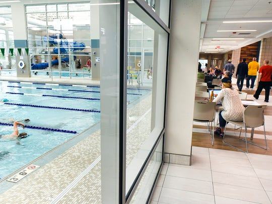 Large windows let in daylight to the pools at the new