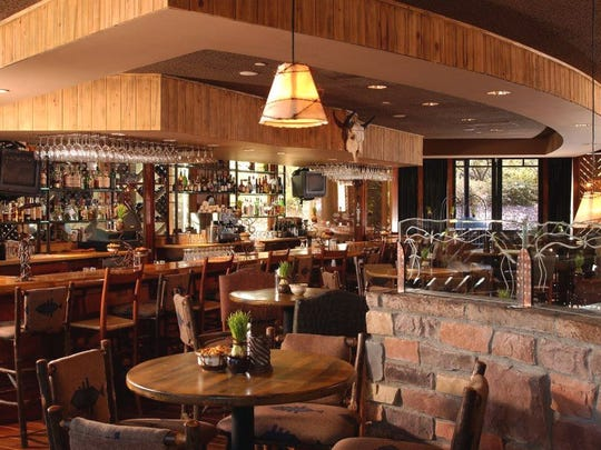 The rustic interior at Roaring Fork in Scottsdale.