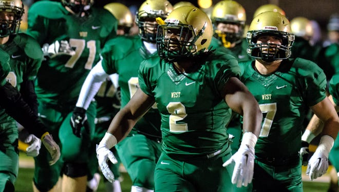 Iowa City West's Yeshuwa Hicks (2) leads the team onto the field to play Cedar Rapids Prairie in Iowa City during the first game of the playoffs on Wednesday, October 28, 2015. (Justin Torner/Freelance for the Press-Citizen)