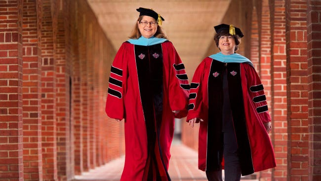 Sisters Anita Cook Hazelwood, left, and Ellen Cook, longtime employees at the University of Louisiana at Lafayette, are the first two graduates to earn a doctorate in Educational Leadership from the University.