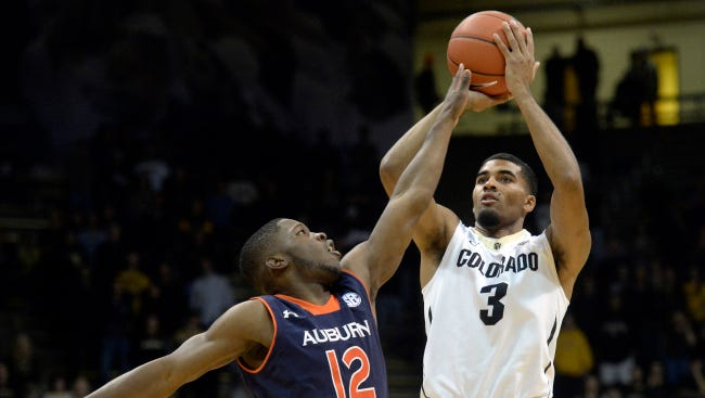 Colorado's Xavier Talton (3) shoots over Auburn's K.C. Ross-Miller (12) during an NCAA college basketball game, Monday, Nov. 17, 2014, at the Coors Event Center in Boulder, Colo. Colorado won 90-59. (AP Photo/The Daily Camera, Jeremy Papasso)