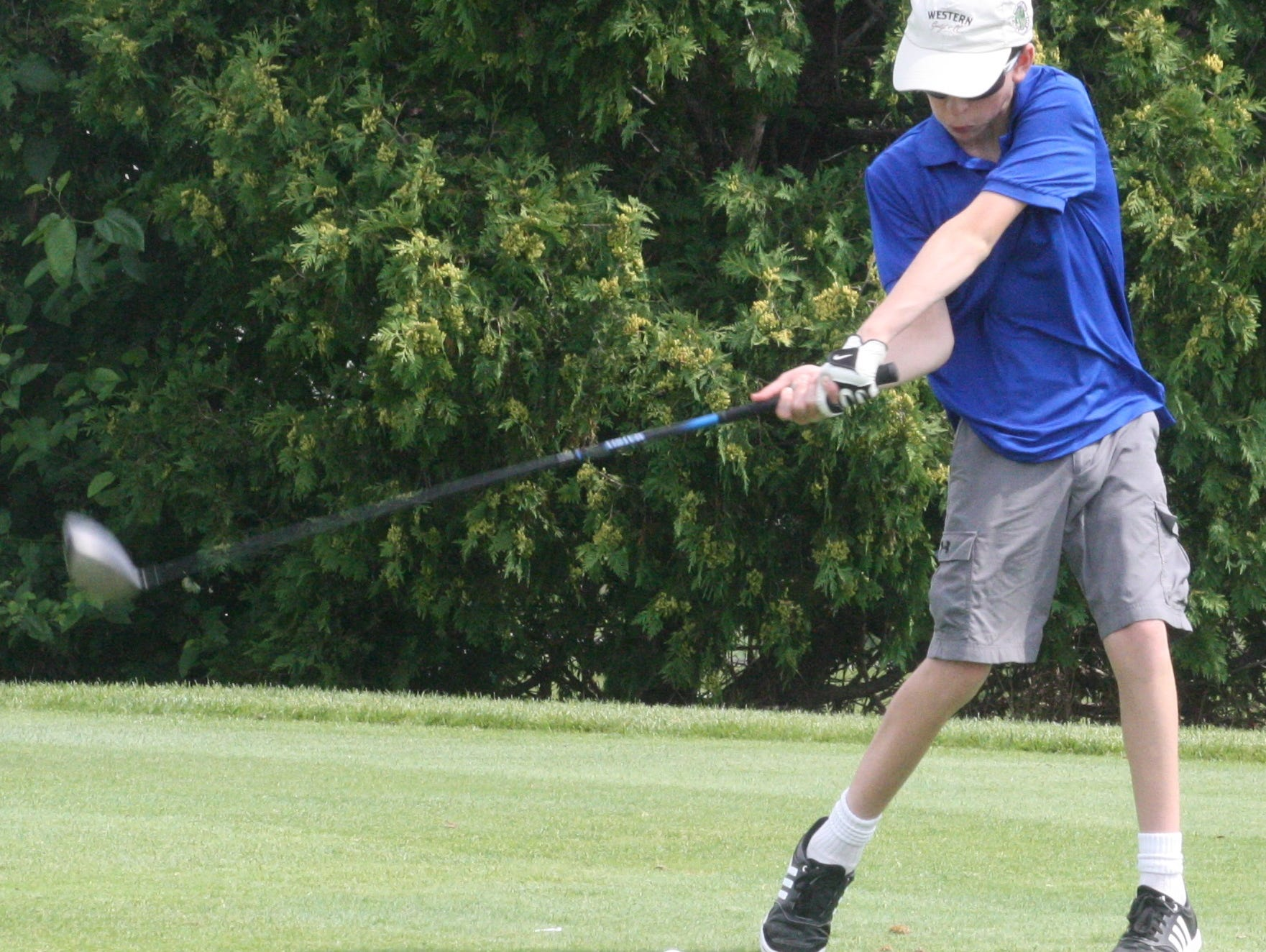 Danny Colleran of Farmington Hills rips a drive down the middle of the fairway Wednesday afternoon.