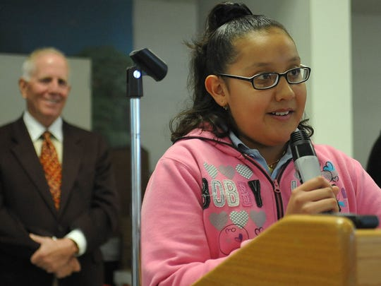 Smithridge Elementary School 5th-grader Jasmine Seguro talks about the importance of the free breakfast program at her school on Nov. 18, 2010. Behind Seguro is Michael Dermody, chairman of Dermody Properties,  who awarded the Washoe County School District and the Northern Nevada Food bank $25,000 each.