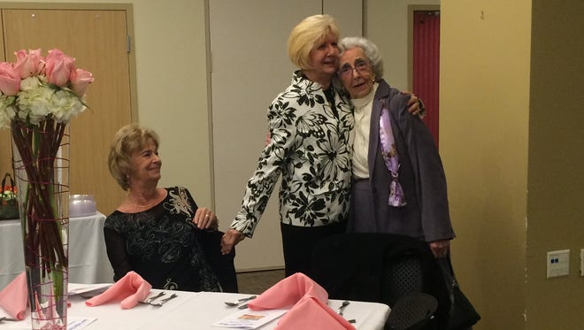 Faye Holloway, center, visits with members of Peninsula Regional Medical Center's Junior Auxiliary Board May 4, 2016.