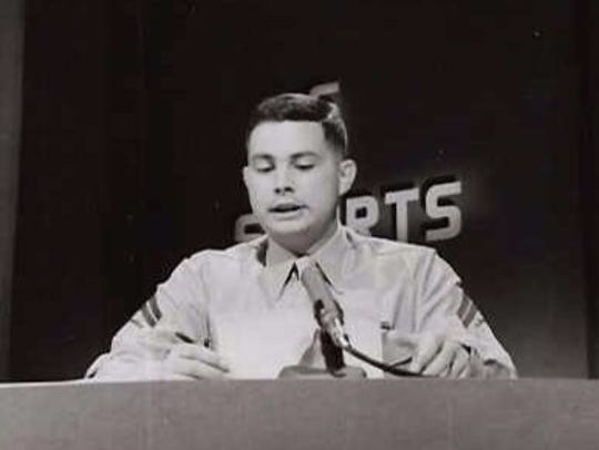Marine Cpl. Al Benn reads the nightly sports report