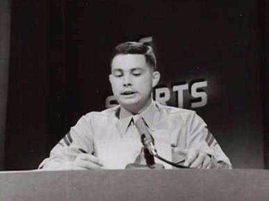 Marine Cpl. Al Benn reads the nightly sports report