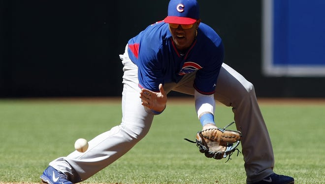 Chicago Cubs shortstop Starlin Castro (13) makes the play for the out against the Arizona Diamondbacks in the fourth inning at Chase Field.