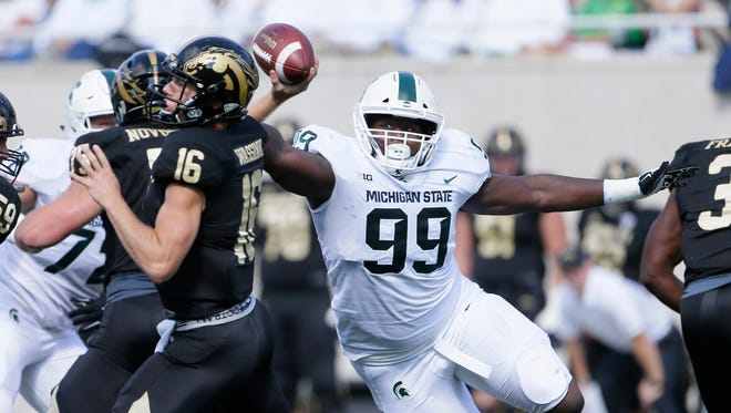 Michigan State defensive tackle Raequan Williams closes in on Western Michigan quarterback Jon Wassink in the first half at Spartan Stadium on Sept. 9, 2017 in East Lansing.