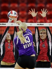 Newman Catholic's Lauren Fech (2) and Rylie Vaughn (4) block against Clayton's Selena Levendoski (13) in the Division 4 championship match at the WIAA state girls volleyball tournament at the Resch Center on Saturday, November 5, 2016, in Ashwaubenon, Wis. Newman Catholic won the championship with a 3-0 victory.
