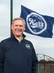 Kar's CEO Nick Nicolay pictured under the Kar's flag at the The Corner Ballpark, the former site of Tiger Stadium in Detroit in March 2018.