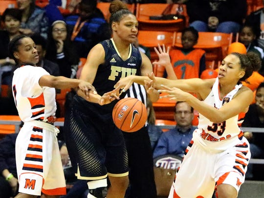 FIU's Brianna Wright, center, is harassed by UTEP's