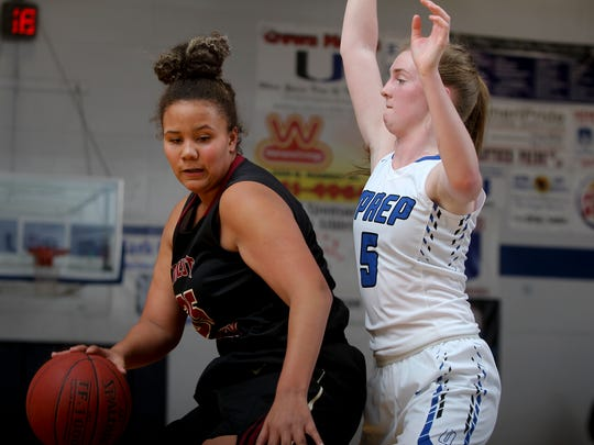 West Valley's Ashlee Lewis tries to take the ball around U-Prep's Colette Cox in a 2017 game.