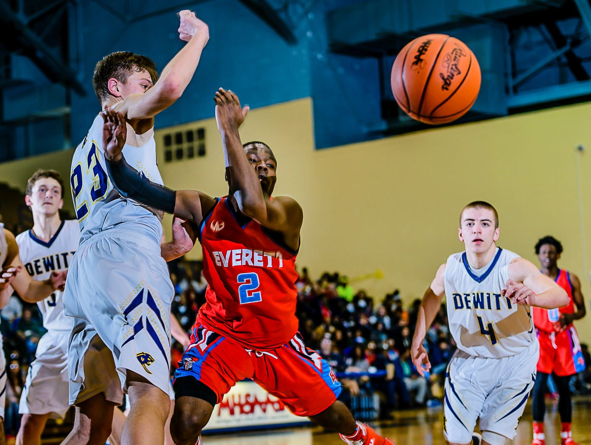 Nyreel Powell ,2, of Everett is fouled by Eddie Daley ,23, of DeWitt with 1:08 remaining in their Class A district semifinal game and DeWitt leading 46-45 Wednesday March 8, 2017 at Don Johnson Fieldhouse in Lansing. Powell would sink 1 of 2 freethrows to tie the game. KEVIN W. FOWLER PHOTO