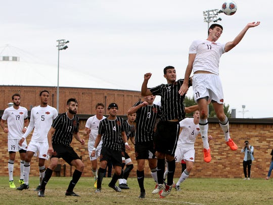 Midwestern State's Scott Doney heads the corner kick