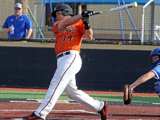 Burkburnett's Wyatt Grant hits a flyball in the game against Childress Friday, March 9, 2018, in Henrietta.