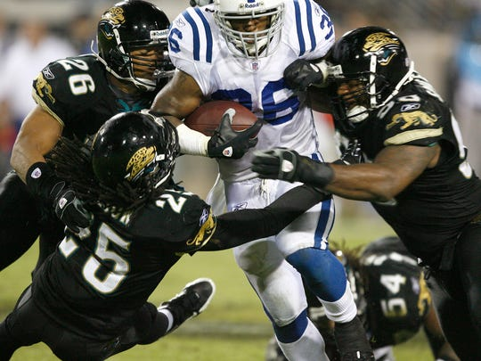 The Colts' Kenton Keith drags three Jags defenders