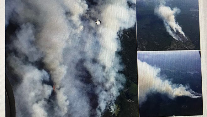 Aerial photos of the Altona Flat Rock State Forest wildfire in northern New York state were tweeted out midday Friday, July 13, by the New York state Department of Environmental Conservation. Vermont firefighters were helping battle the blaze.