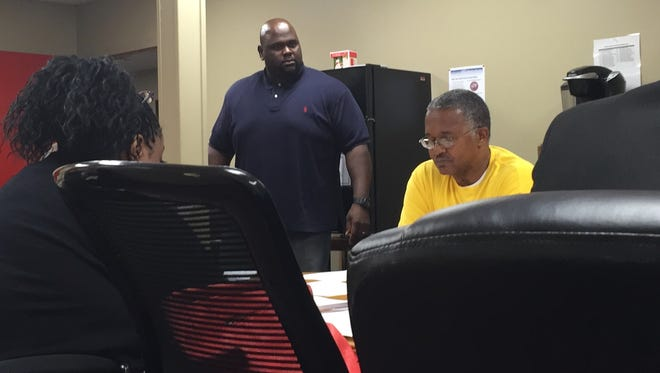 Osaro Kyles, standing, stood up and angrily addressed the room Monday evening after he didn't see his name or title on the agenda for staff confirmations at the Excellence Academy board of directors meeting.