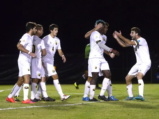 Pfeiffer players celebrate a goal in the first half in a game against Charleston Thursday during NCAA Division II Men's Soccer Nationals in Pensacola. Pfeiffer won 2-1 in overtime.
