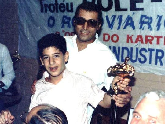 A young Tony Kanaan celebrates with his dad, Antoine.