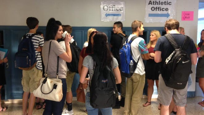 Silver Creek High students gather in the hallway before the first day of school on July 26, 2016. The district is looking to address overcrowding at the more than 900-student school.