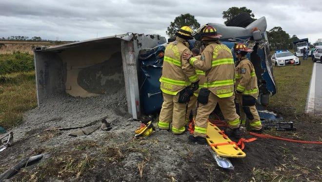 Crews work the scene of a rollover crash Monday, Jan. 8, 2017, in Indiantown.