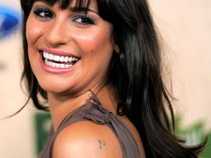 "Lea Michele told David Letterman in 2012 that she has 14 tattoos, mostly hidden in ""secret spots."" But some can be spotted when she hits the red carpet. Here are some musical notes on her shoulder, which she showed off at a 2011 event in Culver City, Calif."