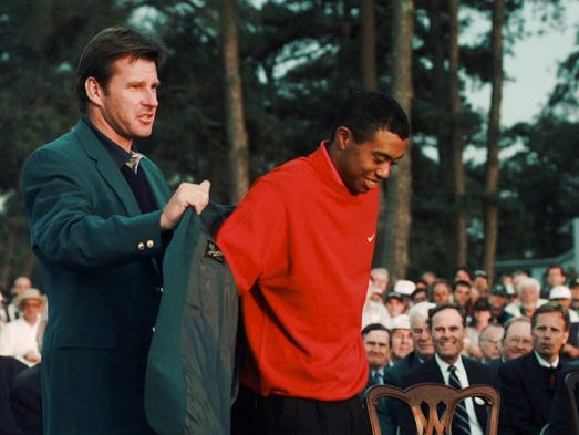 Tiger Woods receives his green jacket from 1996 Masters