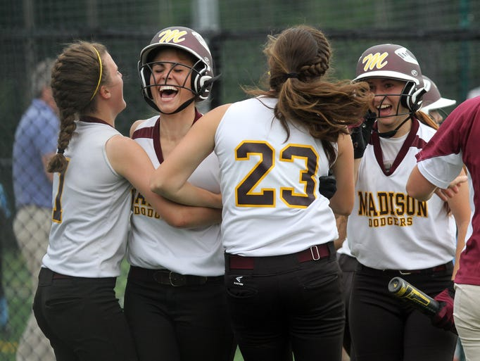 Madison's Jill Caruso celebrates with her teammates after scoring the winning run in the 6th inning against Whippany Park during the North Jersey, Section 2, Group 2, state tournament semifinal at Madison High School Tuesday May 27, 2014.