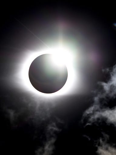 The solar eclipse begins to move from totality in Sylva,