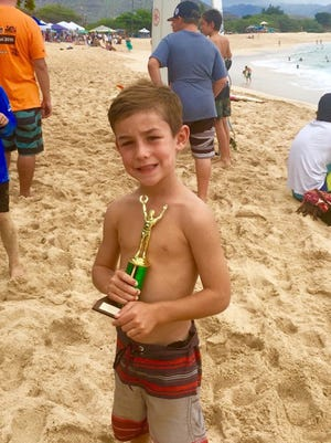 Guam's Wyatt Starley, 7, took fourth place in the 7 to 9 boys longboard division of the Rell Sunn Menehune Surf Championships.